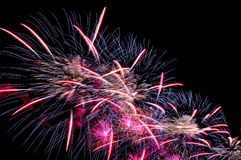Flash of festive salute colorful fireworks against the black nig Stock Photos