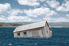 Flash Flood. Old Home in river - Flash Flood royalty free stock images