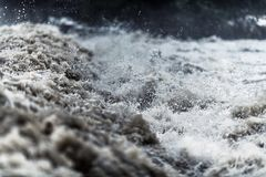 Flash Flood Water. Rushing Flash Flood Water Closeup Photo. Flood Disaster stock photos