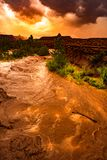 Flash Flood Waters flows through the Canyonlands Needle District. Flash Flood Waters after the storm flows through the Canyonlands Needle District Utah USA stock photos