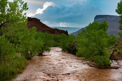 Flash Flood Waters flows through the Canyonlands Needle District. Flash Flood Waters after the storm flows through the Canyonlands Needle District Utah USA royalty free stock photo