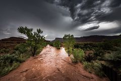 Flash Flood Waters flows through the Canyonlands Needle District. Flash Flood Waters after the storm flows through the Canyonlands Needle District Utah USA stock photo