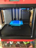 Flash forge 3D print job Blue police box. Blue police box printed with pla filament on Flashforge 3D printer plus other proprietary print jobs on a shelf belies Stock Image