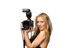 Flash gun. Portrait of a beautiful young blond female with camera, isolated on white Stock Photo