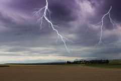 Flash lightning over a small village Royalty Free Stock Photo