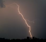 Flash of lightning during a thunderstorm stock photos