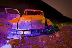 Flash Lit Old Chevy Car. Abandoned Car lit with multiple gelled flash bursts at night Stock Photo