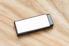 Flash memory drive. On wooden desk background Royalty Free Stock Photos