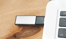 Flash memory drive. Pluged in computer royalty free stock images