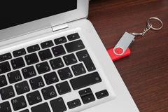 Flash memory drive plugged into a laptop port Royalty Free Stock Images