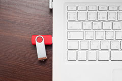 Flash memory drive plugged into a laptop port Stock Photos