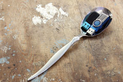 Flash memory on spoon Stock Image