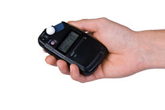 Flash meter in hand Royalty Free Stock Image