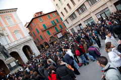 Flash Mob. Pisa - 2010 March 19: People frozen during a flash mob on pisa city centre stock photography