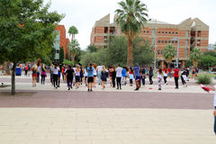 Flash Mob. College students flash mob dancing in a public area stock photography