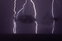 Flash over tropical water Stock Photography