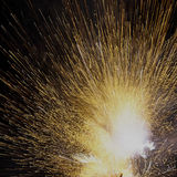 Flash of sparks from an exploding firework Royalty Free Stock Photo