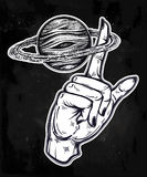 Flash style human hand spinning Saturn planet. Flash Astronomy. Human hand, finger spinning Saturn space planet, celestial drawing. Dotwork ink tattoo vintage Royalty Free Stock Photos