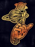 Inked hand, finger spinning Saturn space planet. Flash tattoo style astronomy. Inked human hand, finger spinning Saturn space planet. Dotwork ink tattoo vintage Stock Image