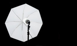 Flash umbrella on black Stock Images