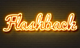 Flashback neon sign on brick wall background. Royalty Free Stock Photo