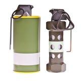 Flashbang and yellow smoke grenade Royalty Free Stock Photo