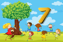 Flashcard number 7 with seven children in the park Royalty Free Stock Photo