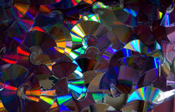 Flashed with different colors of broken DVD discs. stock photo