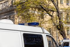 Flasher police car. Flasher on the roof of a police car with tinted windows royalty free stock photos