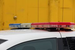 Flasher on the roof of a police car. Yellow background royalty free stock photo