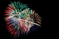 Flashes of green red blue golden and white festive salute Royalty Free Stock Photo