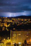 Thunderstorm in the city. Flashes over the city during a big summer thunderstorm Royalty Free Stock Image