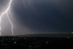 Thunderstorm in the city. Flashes over the city during a big summer thunderstorm Stock Image