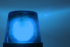 Flashing blue light stock photos