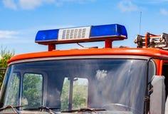 Flashing Blue Siren Light on red firetruck. Close-up of the Flashing Blue Siren Light on roof of red firetruck Stock Photos