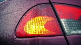 Flashing Car Back Light In The Rain stock footage