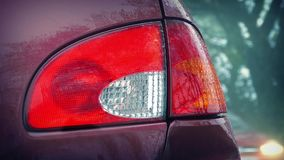 Flashing Car Light With Passing Cars In The Rain stock footage