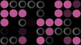 Flashing circles in grey and purple on black stock footage