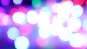 Flashing colored garland used as background. Blinking colorful garlands, blurred effect, used as background stock footage