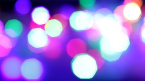 Flashing colorful garlands full frame. Blinking colorful garlands, blurred effect, used as background stock footage