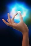 Flashing diamond. Great flashing diamond on hand Royalty Free Stock Photography
