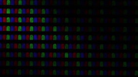 Flashing digital TV Screen Pixels Macro. Red, green and blue subpixels of RGB pixels in macro. Plasma TV screen in macro. Close-up video of working TV screen. PC stock video
