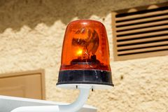 Flashing emergency light siren mounted on a car stock images