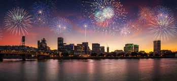 Free Flashing Fireworks On A Dramatic Sunset Sky With Portland, OR Cityscape With Willamette River Stock Image - 53671731