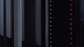 Flashing LED lights at working data servers. Orange and green lights. 4K.  stock video