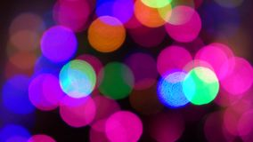 Flashing lights of the Christmas tree. Out of focus stock video
