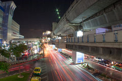 Flashing lights. Cross road. Night time. Blurred lights at the City road and BTS Skytrain Track in Bangkok, Thailand Royalty Free Stock Image