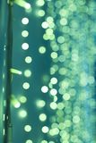 Flashing lights. Green abstract background. Led lights with bokeh background. stock image