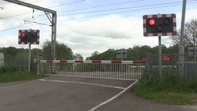 Flashing lights at a level crossing stock video footage