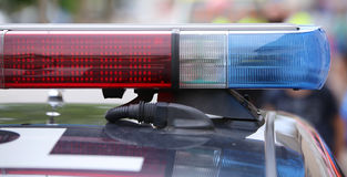 Flashing lights on the police car on patrol in the city Royalty Free Stock Image